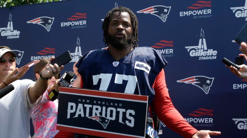 Patriots defensive lineman Michael Bennett faces reporters following practice Sunday.